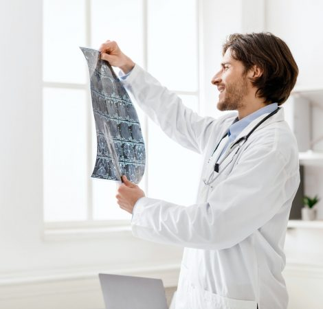 Young medical doctor checking good x-ray scans